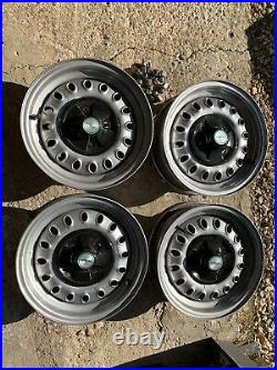 Triumph Spitfire 1500 steel wheel set with centre caps and locking nuts
